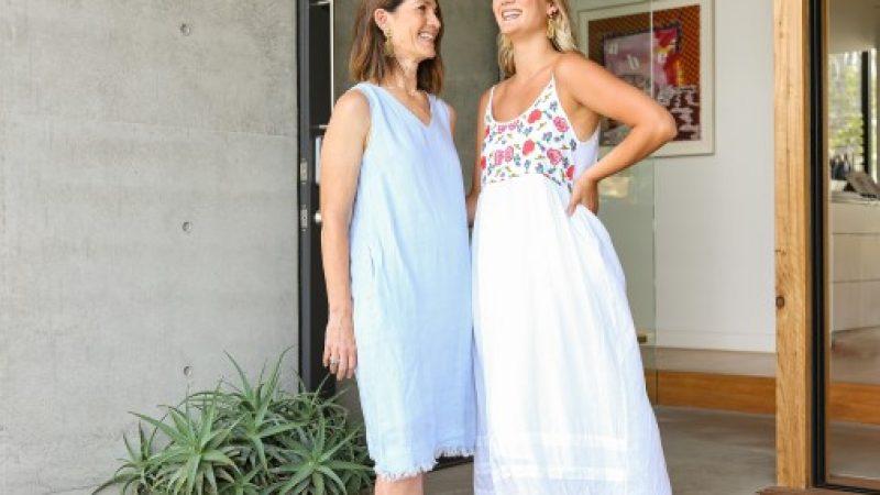 Two women wearing Adrift dresses