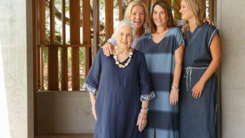Four women standing wearing Adrift Dresses in Navy