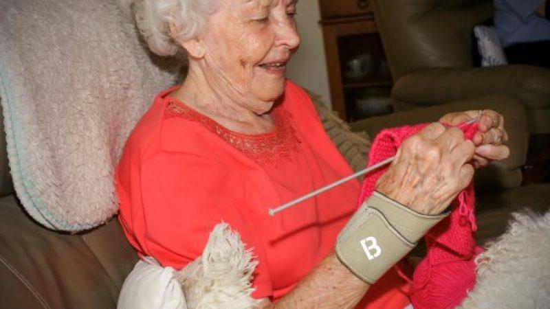 Woman knitting wearing biomagnetic wrist guard
