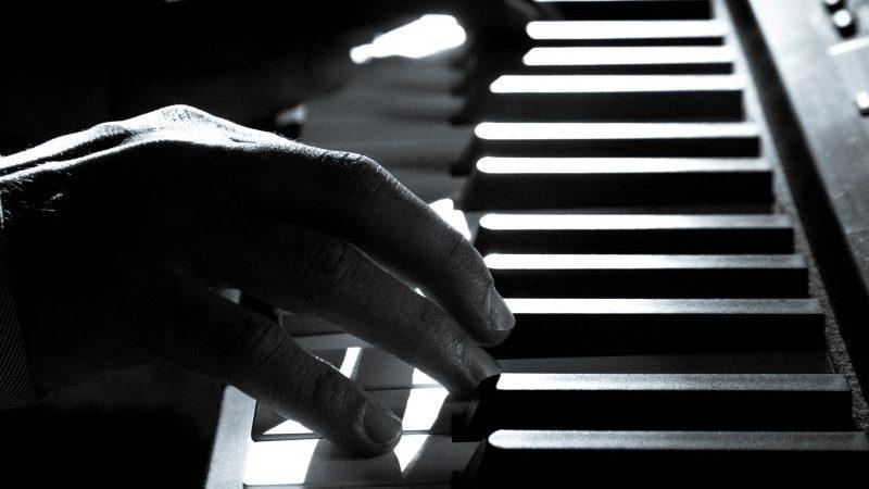 male hands on piano keyboard
